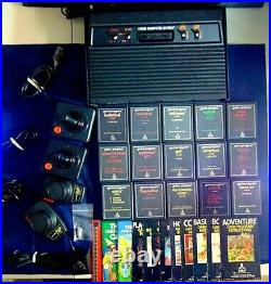 Atari 2600 Console/Game Lot Of 33 Vader Console Joysticks Paddles 15 Games More