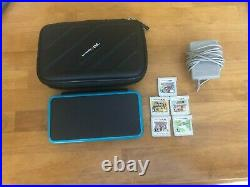 Nintendo 2DS XL Handheld System Black & Turquoise Includes 5 games and a case